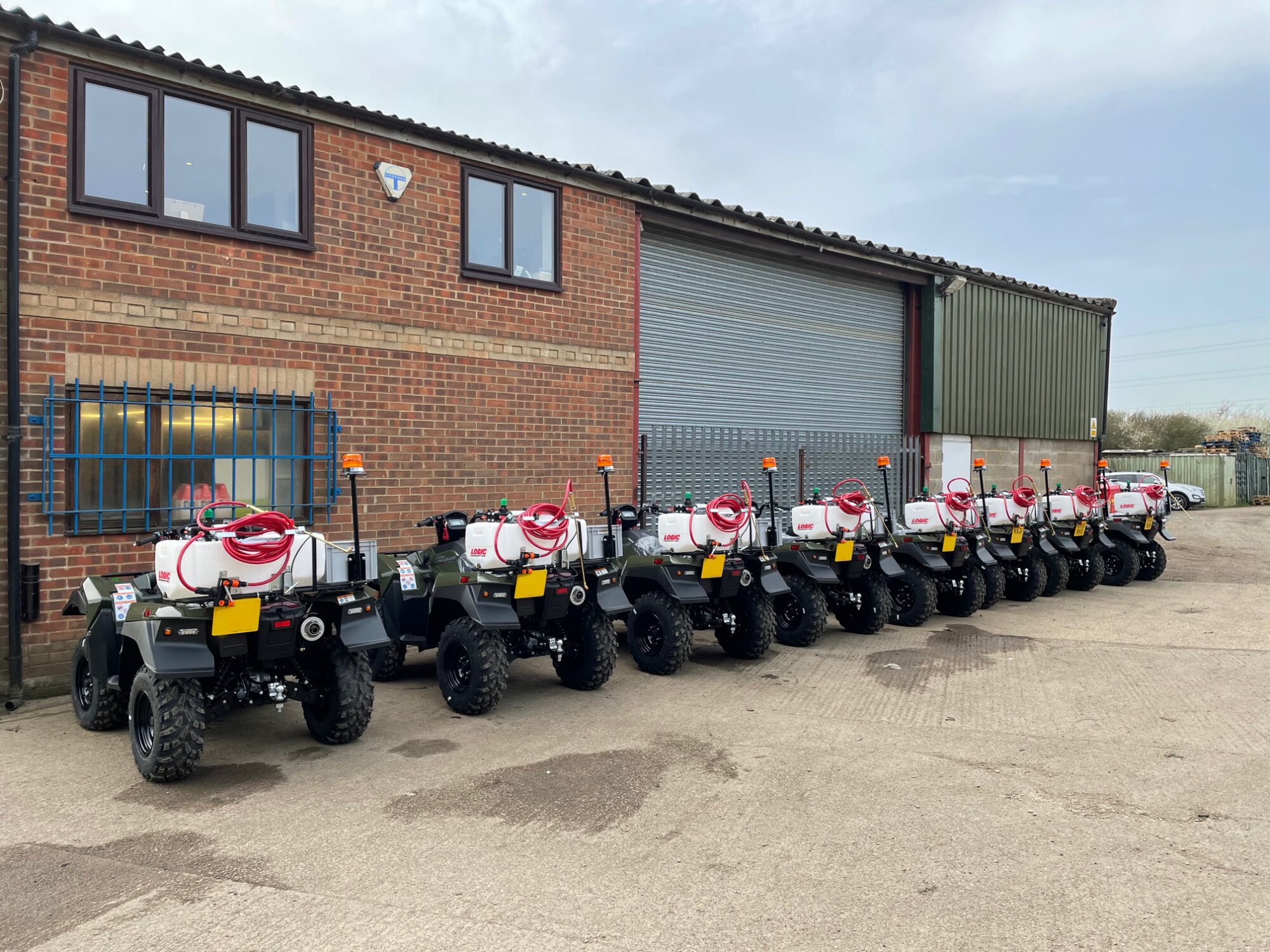 Suzuki ATVs lined up outside the Bedfordshire workshop