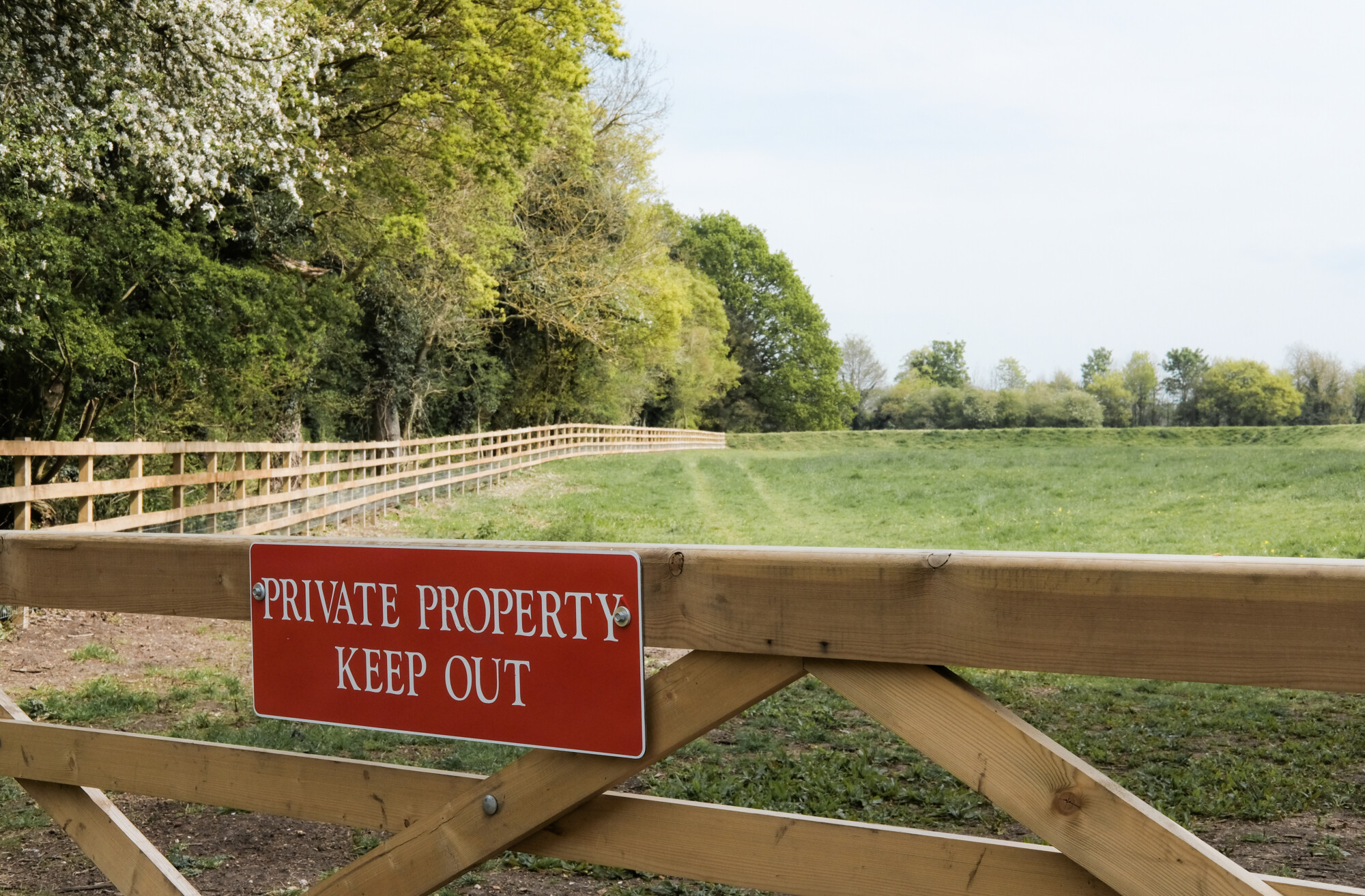 Newly installed Private Property sign erected onto a farm paddock gate in a rural location. Preventing rural crime